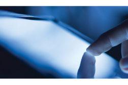 finger on tablet
